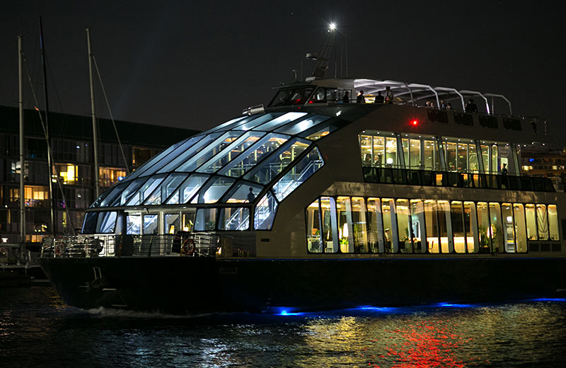 Experience luxury dining on board a glassboat dinner cruise in Sydney